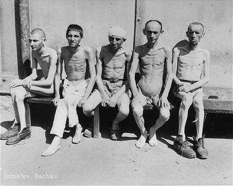 Prisoners liberated in Dachau. (Photo: Francis Robert Arzt, courtesy of USHMM Photo Archives.)